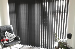 Dark vertical blinds